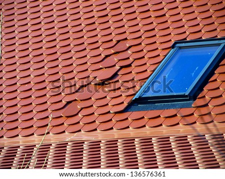 part of the red roofs of wrongly laid tile - error in execution of construction works - stock photo