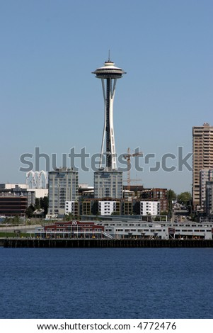 part of the seattle washington skyline as seen from a boat on the water in puget sound - stock photo