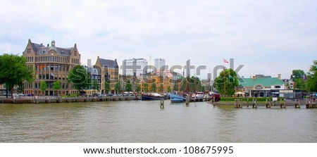 part of the skyline of rotterdam seen from the maas river - stock photo