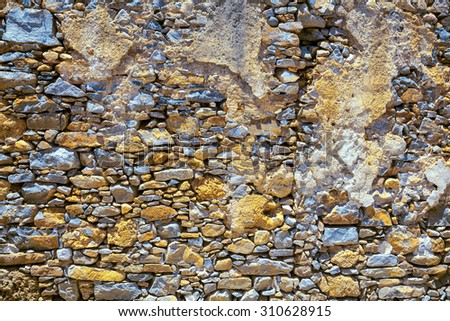Part of the stone wall on the island of Spinalonga. - stock photo