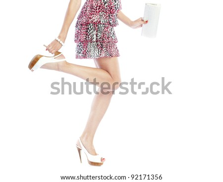 Part of the woman in dress posing on a white background and holding handbag - stock photo