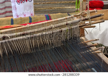 Part of traditional vintage belorussian weaving hand loom with wool close up - stock photo