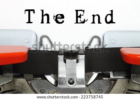 Part of typing machine with typed The End words   - stock photo