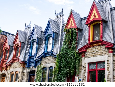 Part of Victorian houses facade, seen from the west side with the color of the roof in Montreal - stock photo