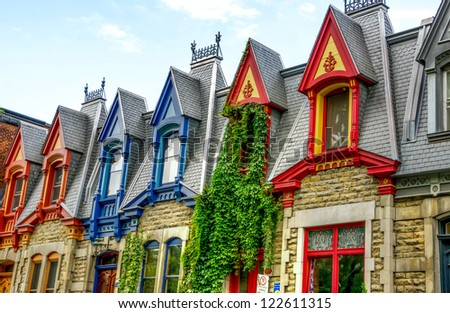 Part of Victorian houses seen from the west side with the color of the roof in Montreal, HDR image - stock photo
