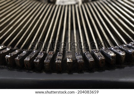 part of vintage portable typewriter with Cyrillic letters - stock photo
