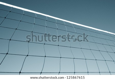 Part of volleyball net against sky - stock photo