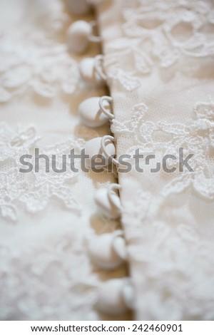 Part of wedding dress , buttons  - stock photo