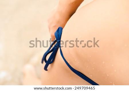 Part of woman body in swimwear - stock photo