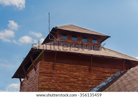part of wooden house with sky in background - stock photo
