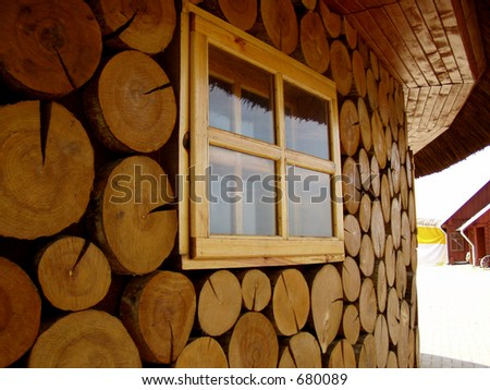 Part of wooden house with window - stock photo