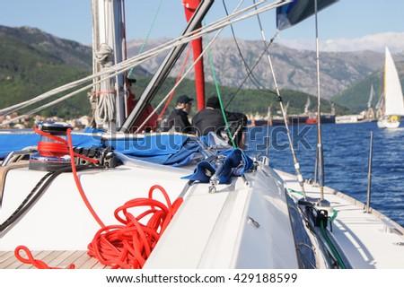 "Part of yacht rigging. Tivat, Montenegro - 26 April, 2016. Regatta ""Russian stream"" in God-Katorskaya bay of the Adriatic Sea off the coast of Montenegro. - stock photo"