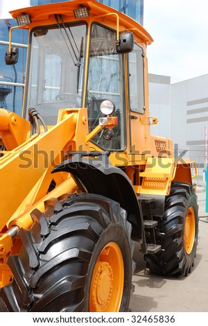 Part of yellow bulldozer