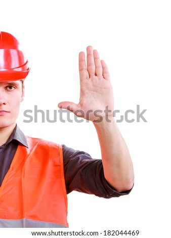Part of young man construction worker builder foreman in orange safety vest and red hard hat showing stop sign hand gesture isolated on white. No entry- safety in industrial work. Studio shot. - stock photo