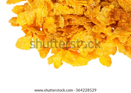 Part pile of corn flakes isolated on white background - stock photo