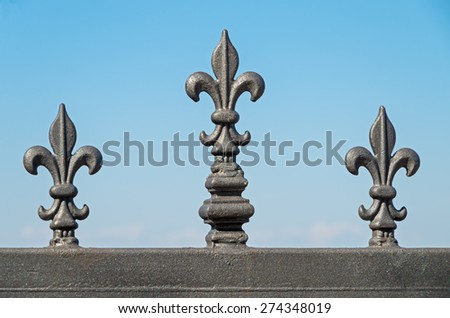 Part wrought fence covered with corrosion-resistant coating on a background of blue sky - stock photo
