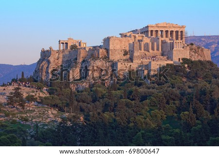 Parthenon on Acropolis hill in the afternoon with the national guard climbing the stairs to retrieve the flag - stock photo
