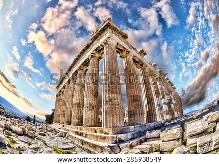 Parthenon temple with cloudy sky on the Acropolis in Athens, Greece - stock photo