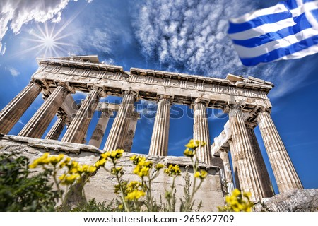 Parthenon temple with Greek flag  on the Athenian Acropolis, Greece - stock photo