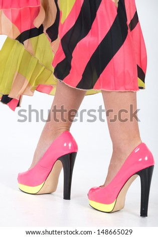 Partial image of a woman's legs and high heels - stock photo