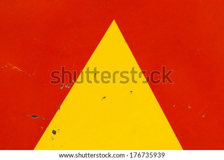 Partial of a strret sign, arrow or triangle background - stock photo