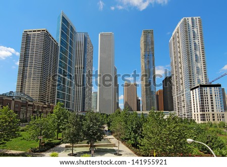 Partial skyline of skyscrapers near the Chicago River in the Loop area at the center of downtown Chicago, Illinois, against a bright blue sky. - stock photo