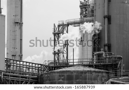 partial view of a factory with smoking chimneys