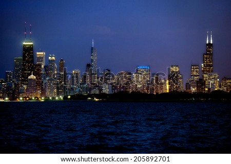 Partial view of Chicago skyline at night - stock photo