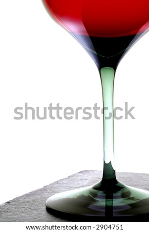 Partial view of  glass of red wine.