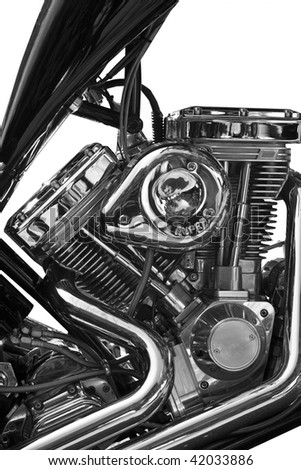 Partial view of motorcycle on white background - stock photo