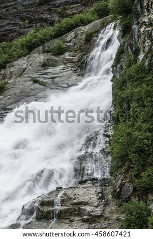 Partial view of Nugget Falls (also known as Nugget Creek Falls and Mendenhall Glacier Falls), a waterfall downstream of Nugget Glacier, north of Juneau, Alaska, USA