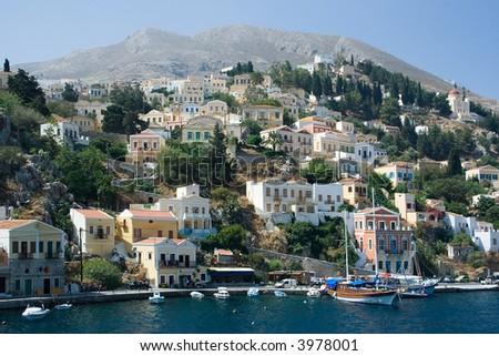 Partial view of Symi harbour, Symi island, Greece - stock photo
