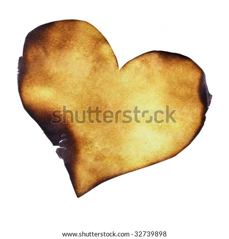 Partially burned paper heart close-up - stock photo