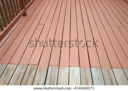 partially painted old wood deck
