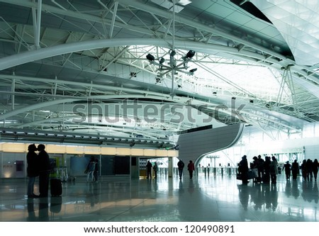 "Parting lovers in modern airport ""Francisco Sa Carneiro"" in Porto, Portugal - stock photo"