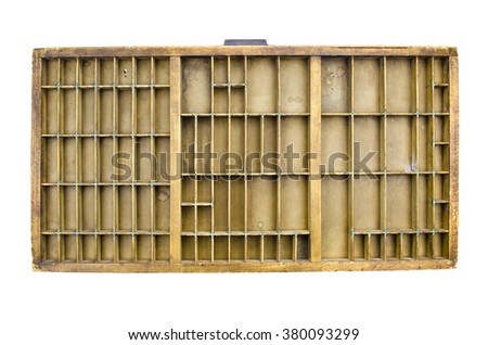 Partitioned antique wooden drawer shelf isolated on white - stock photo