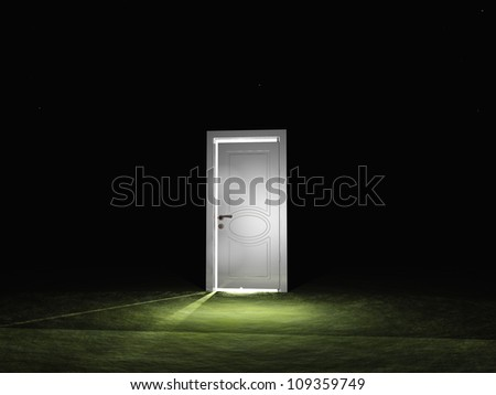 Partly closed door emits light - stock photo