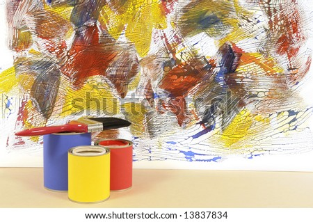 Partly finished untidy or messy painted wall with paint cans and paintbrushes. Space for copy. - stock photo