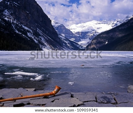 Partly frozen Lake Louise with horn in foreground, Banff National Park, Alberta, Canada. - stock photo