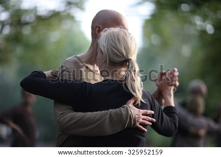 Partner dance, a man leading a woman in the dance - stock photo
