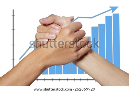 Partner hand between a businessman and woman on graph background - stock photo