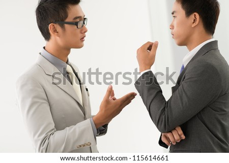 Partners having a discussion advancing reasonable arguments - stock photo