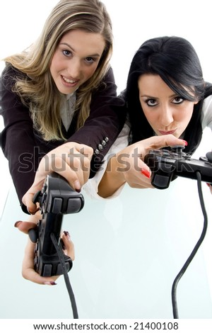 partners playing game and holding remote against white background - stock photo
