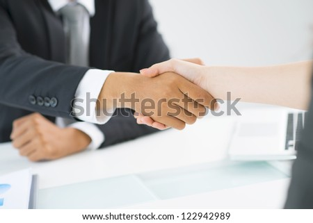 Partners shaking hands to demonstrate mutual respect - stock photo