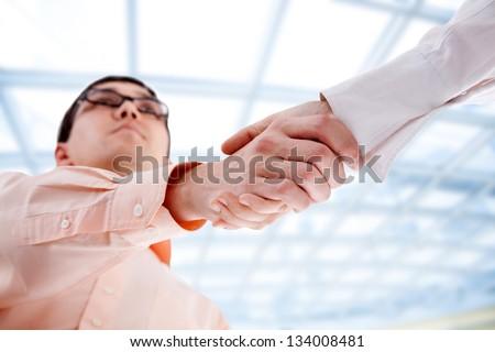 Partnership: business partners making handshake at meeting - stock photo