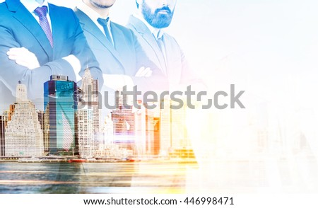 Partnership concept with businespeople crossing arms on New York city background with sunlight. Double exposure - stock photo