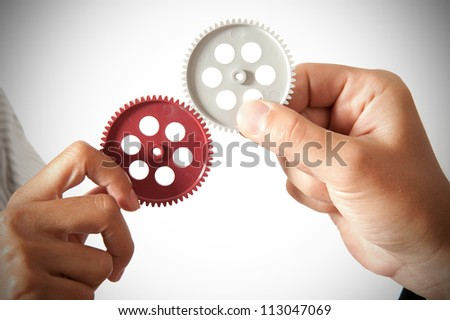 partnership concept with gear and businessmsn - stock photo