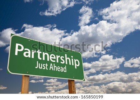 Partnership Just Ahead Green Road Sign Over Dramatic Clouds and Sky.