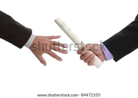 Partnership or teamwork concept two men handing over a paaperwork baton - stock photo
