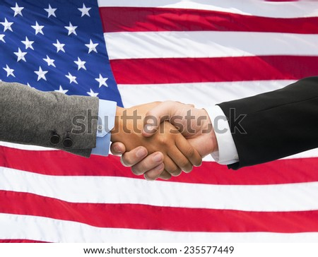 partnership, politics, gesture and people concept - close up of handshake over american national flag background - stock photo